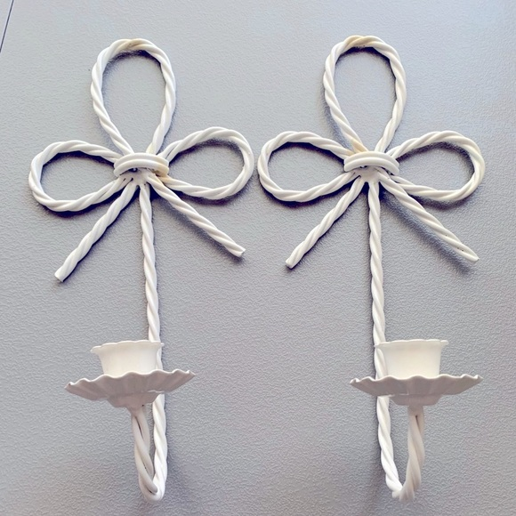 Two hanging bow candlestick holders sconces